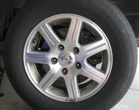 Remove each lug nut and place them in a safe place - change a tire