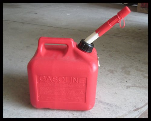 Here is an example of a gas can with a safety device on the nozzle.