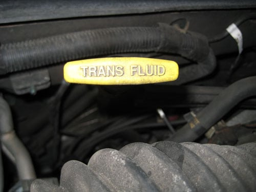 Locate the transmission fluid dipstick - check transmission fluid